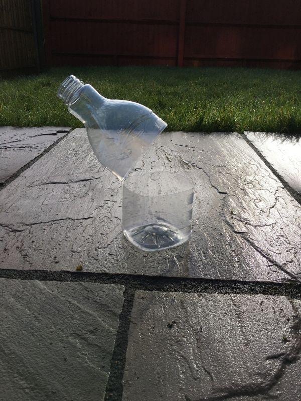 Plastic orange juice bottle for sowing seeds